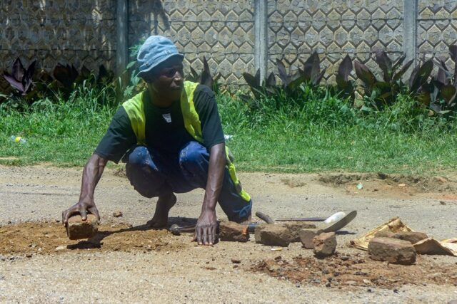 t citizens patching roads an asking for money